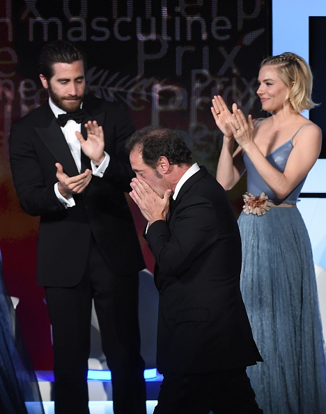 French actor Vincent Lindon arrives on stage after being awarded the prize for Best Actor